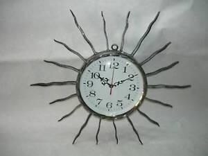 Orologio-da-parete-in-ferro-battuto-RAGGI-RAGGIERA-SOLE
