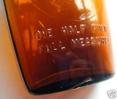 antique-circle-flask-EMBOSSED-1-2pint-full-measureCOLOR