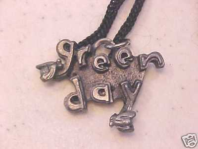OLDER GREEN DAY NECKLACE PENDANT ON ROPE CORD