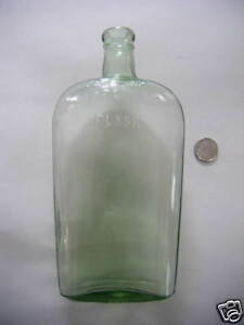 rare antique flask green emb.Warranted circle 28oz.See