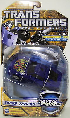 "Hasbro Year 2010 Transformers ""Reveal The Shield"" Series Deluxe Class 6 Inch Tall Robot Action Figure - TURBO TRACKS with 2 Converting Blasters (Vehicle Mode Sports Car) - 25960 Toys"