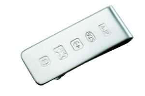 A SOLID SILVER MONEY CLIP WITH FEATURE HALLMARK