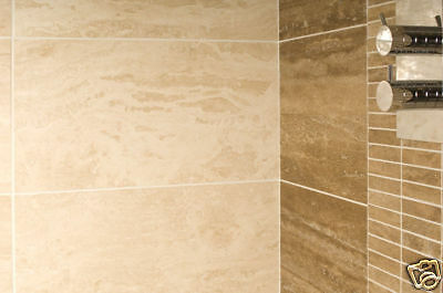 Ivory Vein Cut Polished Travertine Tiles 30.5x30.5x1cm £39.99 Per Sqm