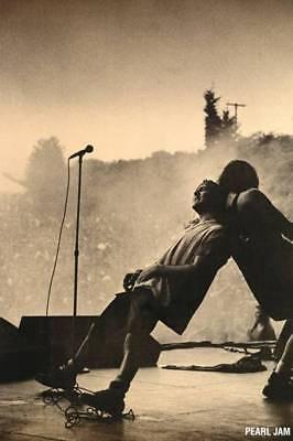 Pearl Jam Eddie Vedder On Stage Leaning on a Bandmate Poster  24 x 36