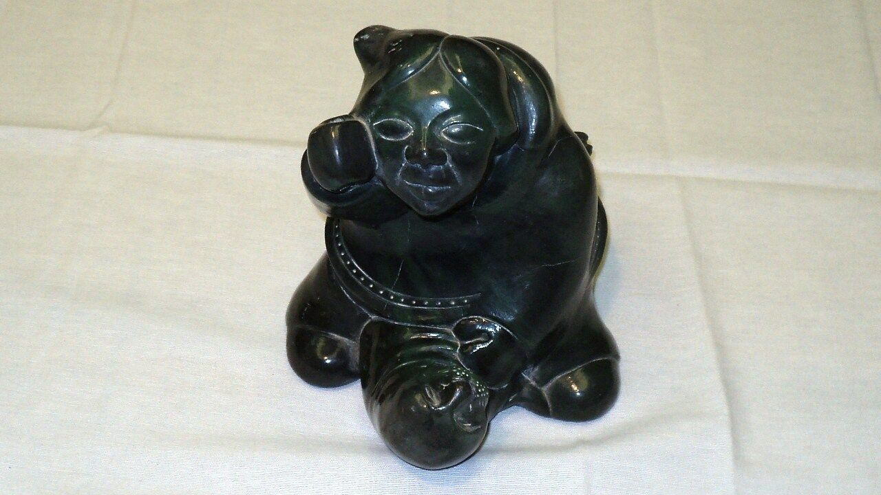 """Green Stone Statue of a North American and Seal Made by Aardvark Canada 7""""x 6.7"""""""