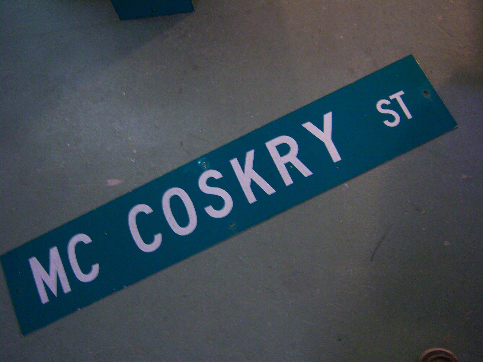 """Large Original Mc Coskry St Street Sign 48"""" X 9"""" White Lettering On Green"""