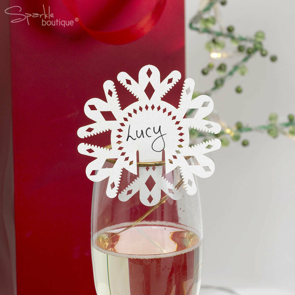 Snowflake place name cards for glass napkin rings for Decoration names for christmas