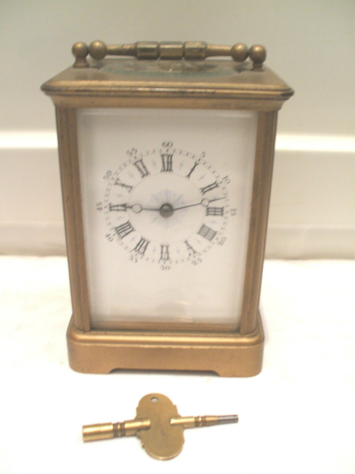 Brass Case French made Enamelled Face Striking Carriage Clock GWO