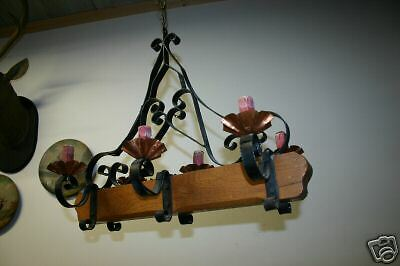 A  French wooden/wrought-iron 6 light castle chandelier