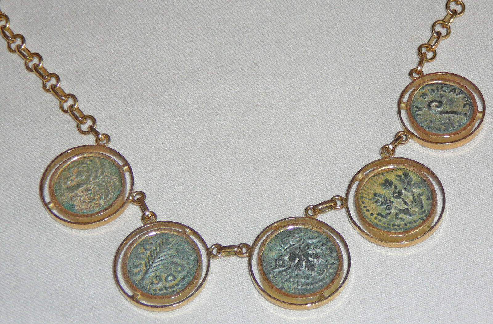 18 Karat gold necklace set with five ancient coins from the Second Temple period
