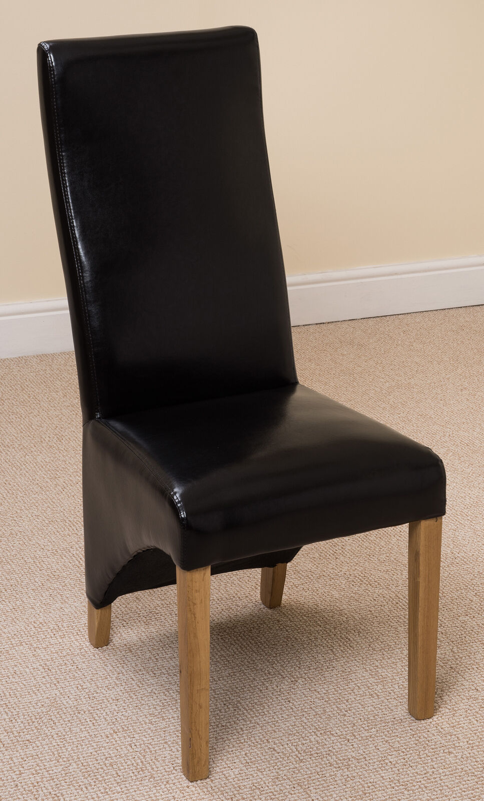 curved back leather dining chairs with solid oak legs in black brown