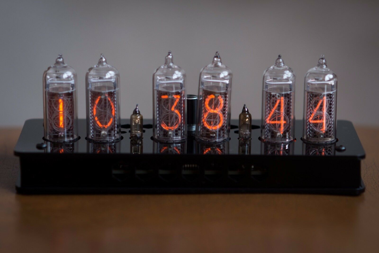 nixie tubes It more or less looks like an ordinary vacuum tube, but if you look closer inside the glass, you can see a bunch of overlapping numbers(0 to 9).