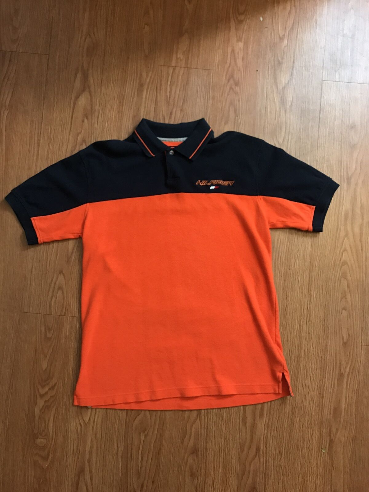 Vintage 90s tommy hilfiger athletics spellout polo shirt for Tommy hilfiger shirt size