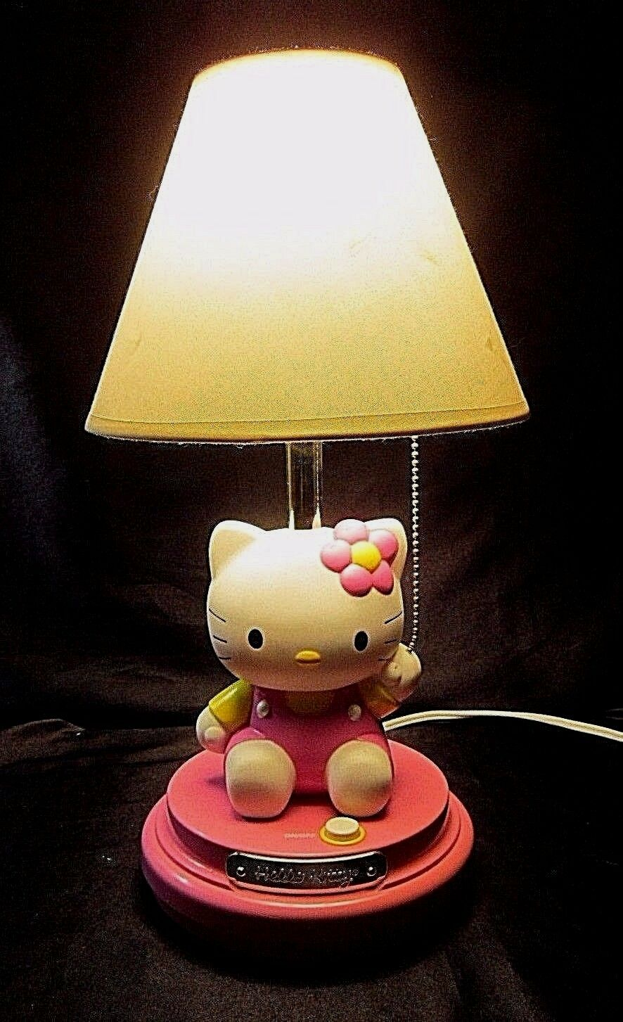 hello kitty table lamp kt3095 features kitty in a pink dress with a flower cad. Black Bedroom Furniture Sets. Home Design Ideas