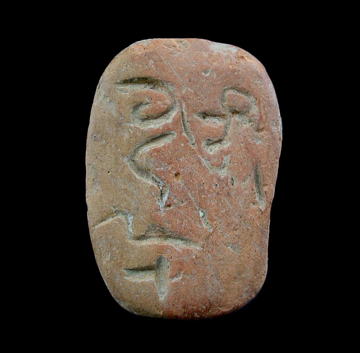 Clay stamp, the underside with an incised inscription x9636
