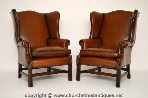 Pair Of Antique Chippendale Style Leather Wing Armchairs