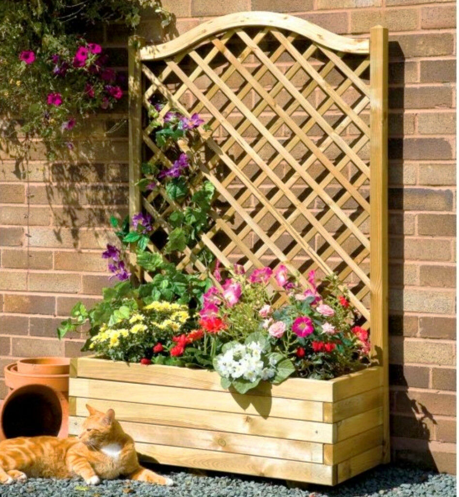 wooden planter with garden fence trellis freestanding