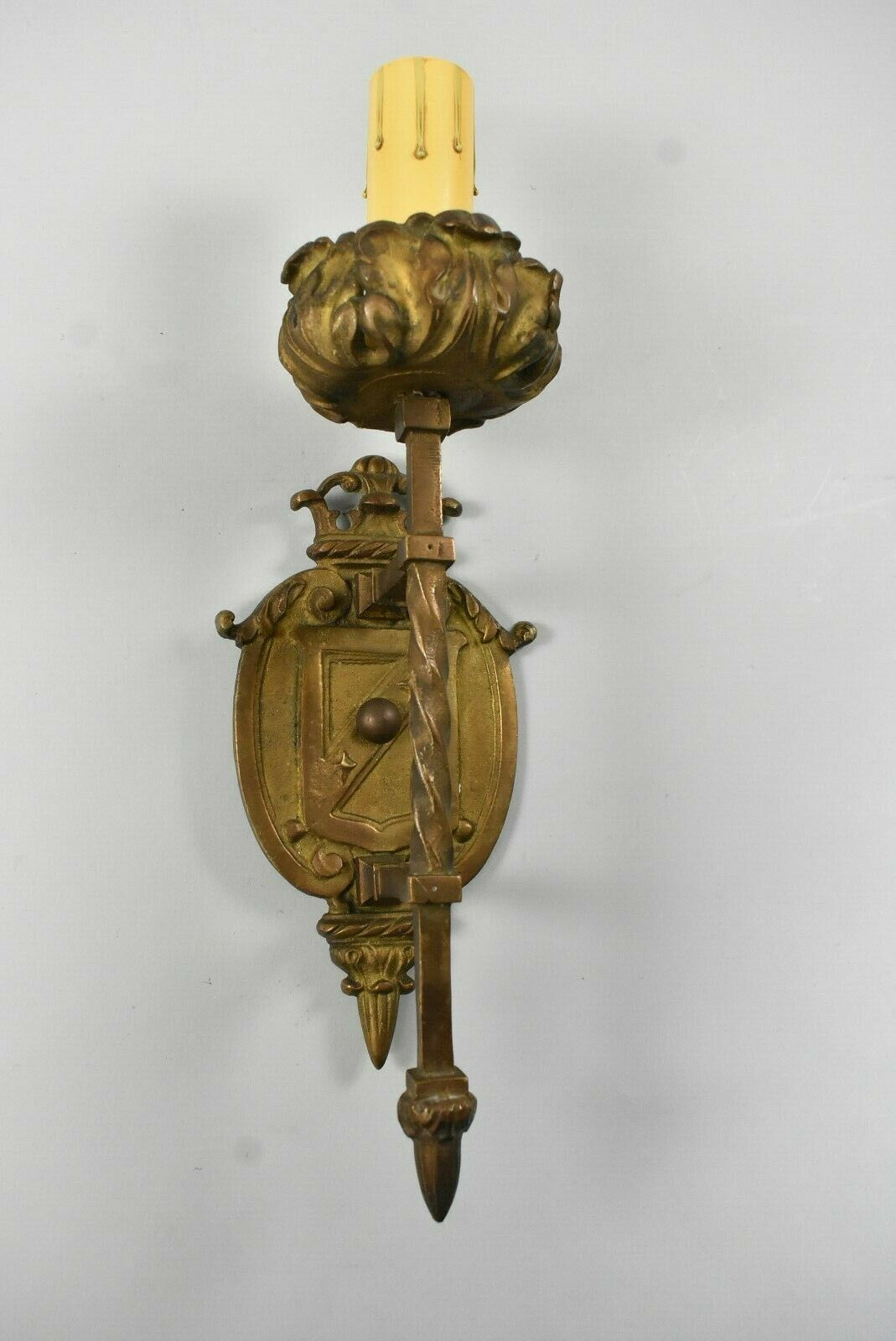 Antique Single Socket Brass Wall Sconce with Twisted Detail and Shield Design