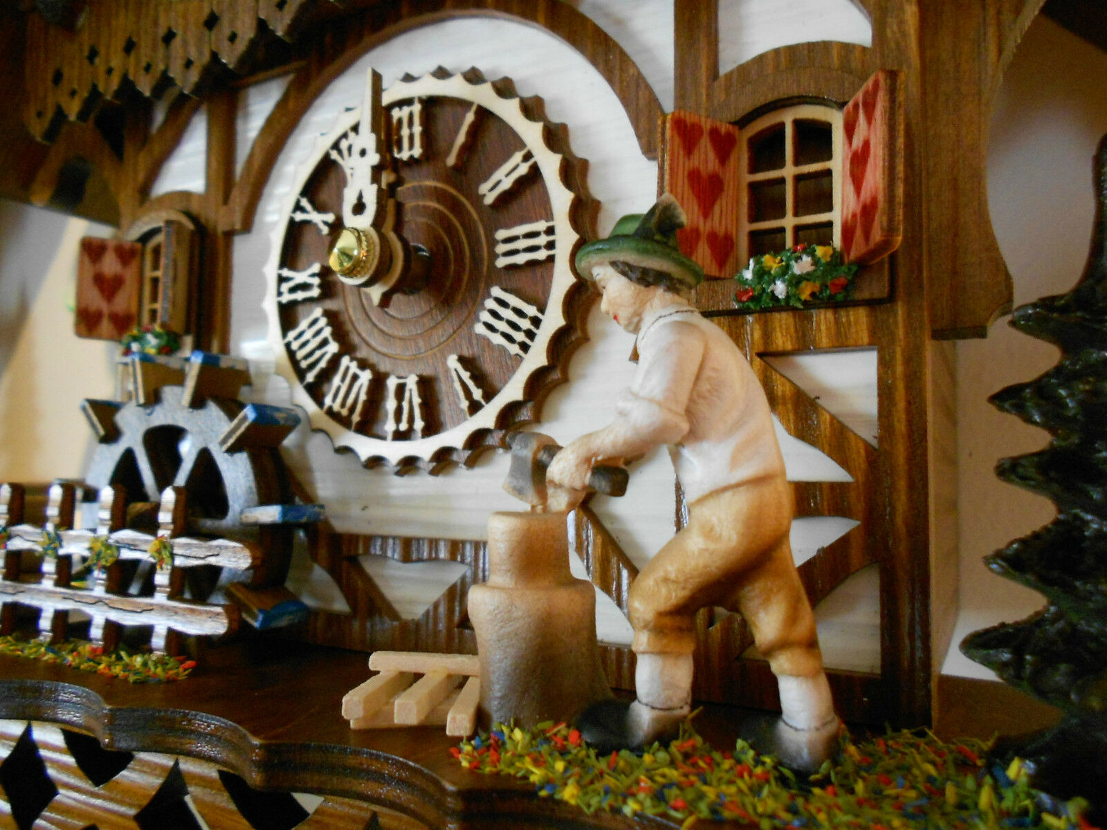 NEW Cuckoo Clock Black Forest House With Music - Move Wood-Cutter and Watermill.