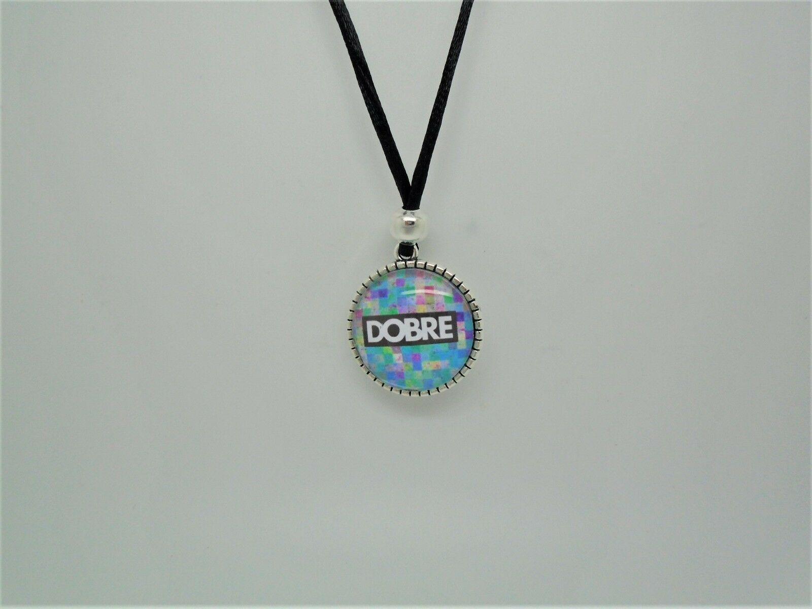 The Dobre Brothers Logo Cabochon Pendant Necklace Surfer Style Cord