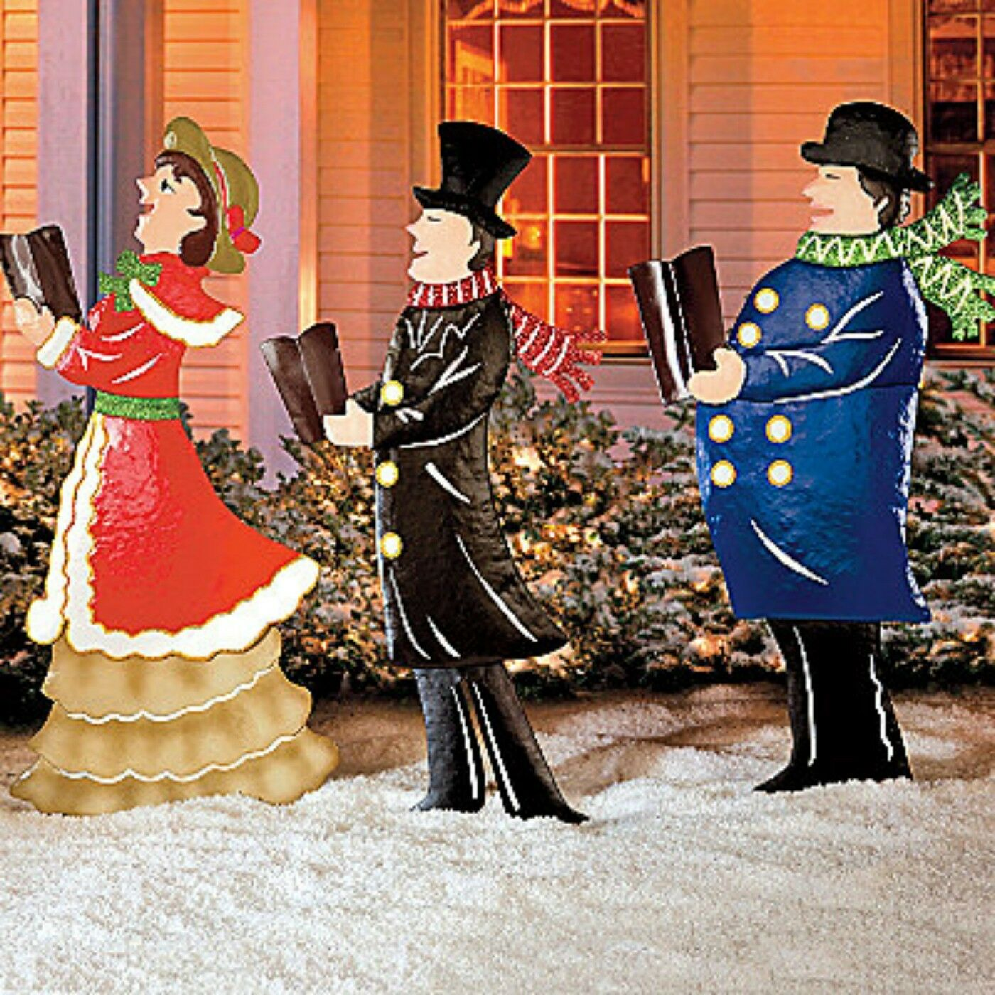 Set of metal christmas carolers outdoor yard display
