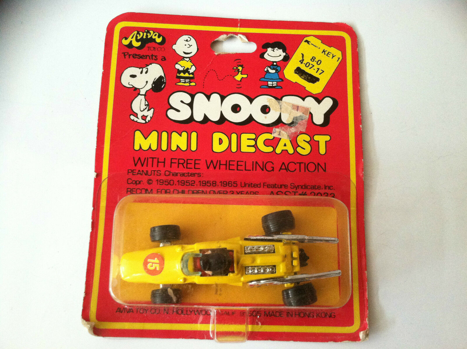 VINTAGE SNOOPY AVIVA TOY CO MINI DIECAST YELLOW RACER WITH LUCY DRIVER  PEANUTS