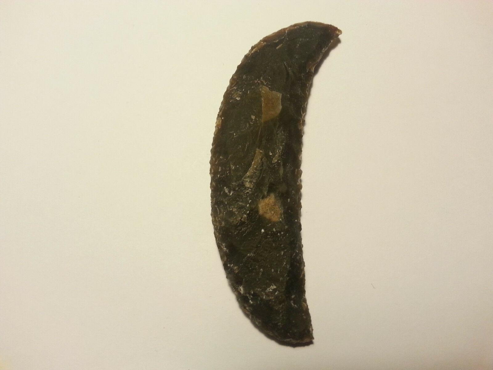 Stone age flint knapping sickle reproduction