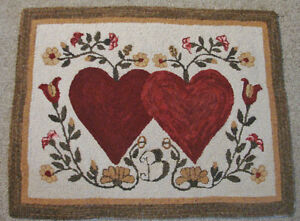 PRIMITIVE-HOOKED-RUG-PATTERN-ON-MONKS-HEARTS-ENTWINED