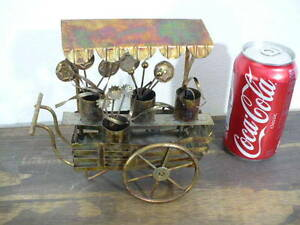 Tin-Art-in-a-peddlers-wagon-7-tall-6-1-2-long-in-excellent-condition