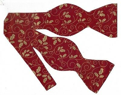 (1) BOW TIE - METALLIC GOLD HOLLY LEAVES & SCROLLS ON DARK HOLIDAY RED