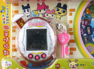 BANDAI-TAMAGOTCHI-V5-WITH-DVD-FAMITAMA-CHINA-VERSION-BROWN