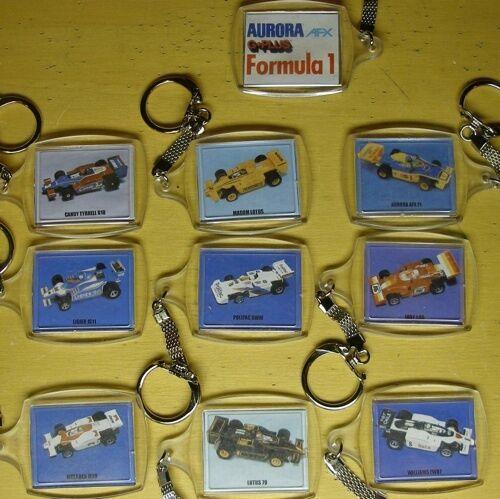 9 Aurora AFX G+ Formula 1 Slot Car Key Chain Set 1980's