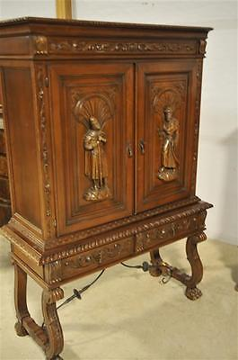 Small Spanish Cabinet with nice carvings, Large feet with metal Stretcher, 1960s