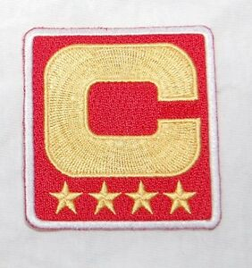 Eli-Manning-New-York-Giants-4-Star-Gold-Captain-Patch-In-Red
