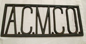 Old-Industrial-Cast-Iron-Sign-A-C-M-C-O