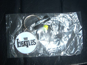 THE-BEATLES-OFFICIAL-APPLE-CORPS-KEY-RING-STILL-IN-POLY-BAG-NEW-BRAND-NEW