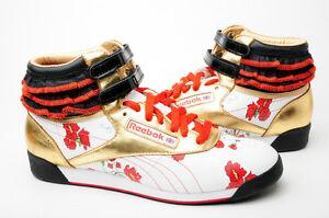 Reebok-Women-039-s-shoes-Freestyle-Hi-CITIES-2-711610-WHT-GOLD