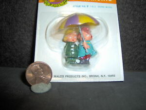 Vintage Plastic Miniature Umbrella Boy and Girl made in 1973