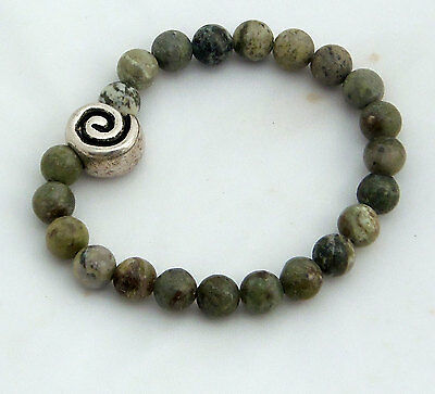 Connemara marble bracelet with a celtic spiral bead, Made in Ireland