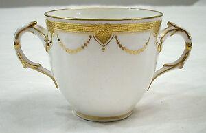 MINTONS PORCEALIN TWO HANDLE CUP WITH 22K GOLD TRIM DAVIS COLLAMORE & CO LTD
