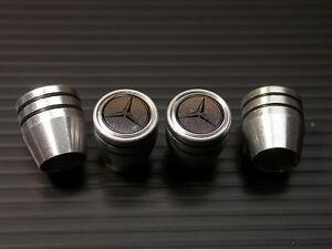Metal valve stem caps set mercedes benz w203 w204 c32 c55 for Mercedes benz valve stem caps