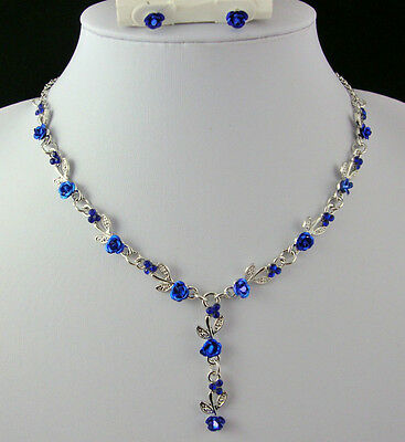 SILVER TONE BLUE METAL ROSE  & ROYAL BLUE CRYSTAL NECKLACE AND EARRINGS SET