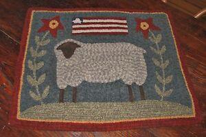 PRIMITIVE-HOOKED-RUG-PATTERN-ON-MONKS-PRIM-SHEEP
