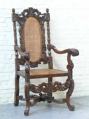 5886-1 : ANTIQUE SPANISH CARVED ARM CHAIR