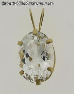 Pale-Blue-Oval-Cut-Topaz-10k-Gold-Pendant