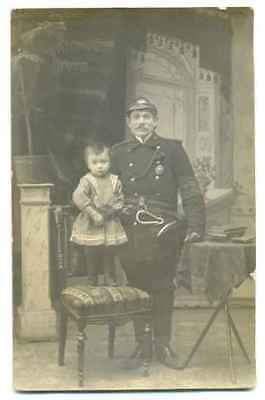 Russian Imperial Fireman with Badge, Helmet, Axe and Baby Photo