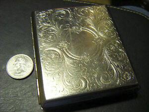 fancy cigarrette case scroll design on front crosshatched on back Excellent See