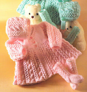 Aran Knitting Patterns For Babies : Aran Style Baby Crew V Neck Matinee Coat Bonnet & Socks DK Knitting Patte...