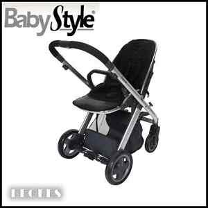 NEW-IN-BOX-BABYSTYLE-OYSTER-STROLLER-IN-SMOOTH-BLACK-WITH-MIRROR-FINISH-CHASSIS