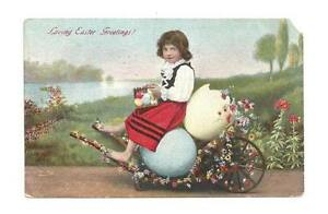 EASTER-Postcard-Child-in-Flower-Egg-Cart-Antique-1909